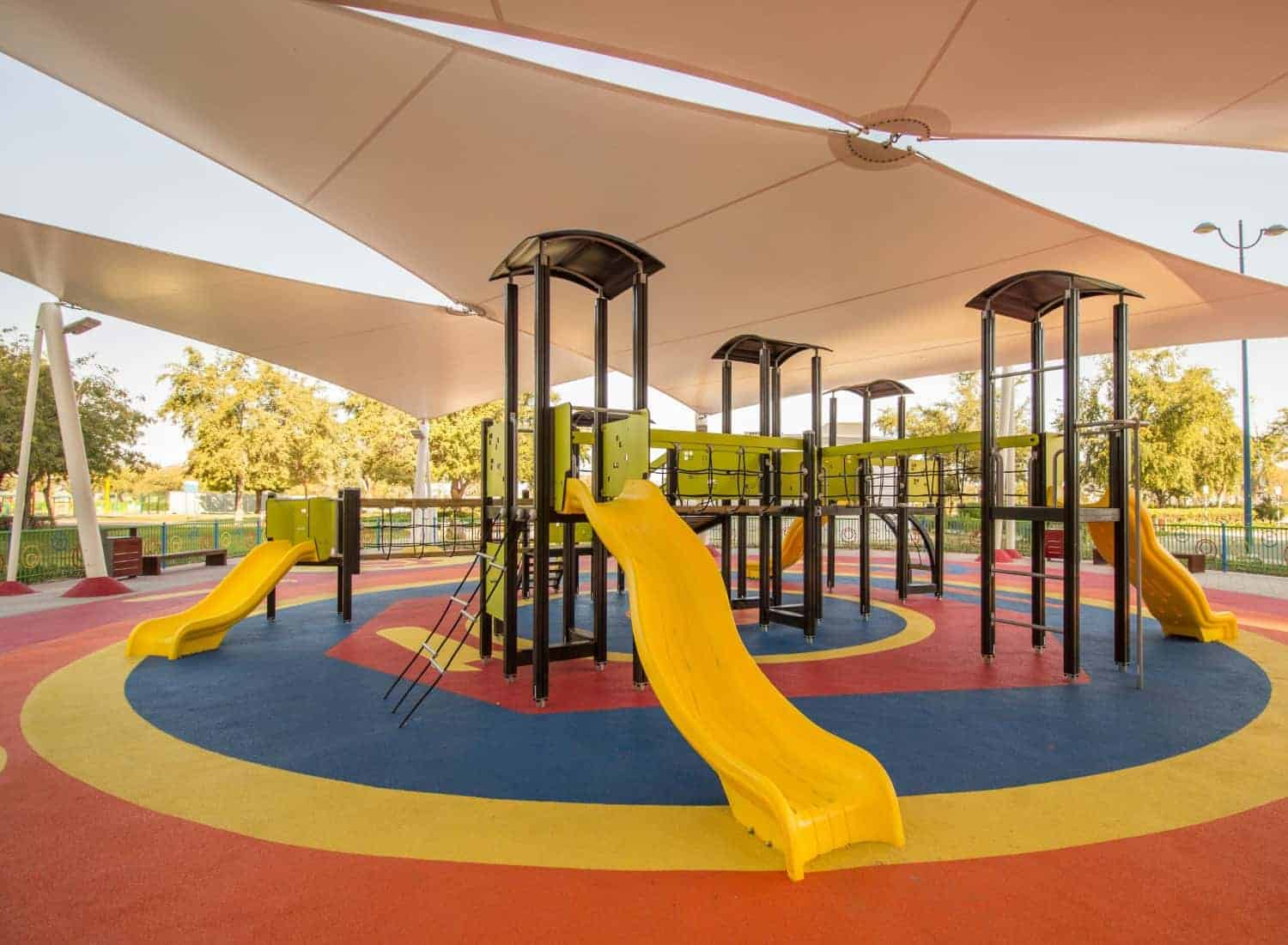 stock-photo-shaded-kid-s-playground-activity-tower-equipment-at-the-lake-park-in-abu-dhabi-1391708588